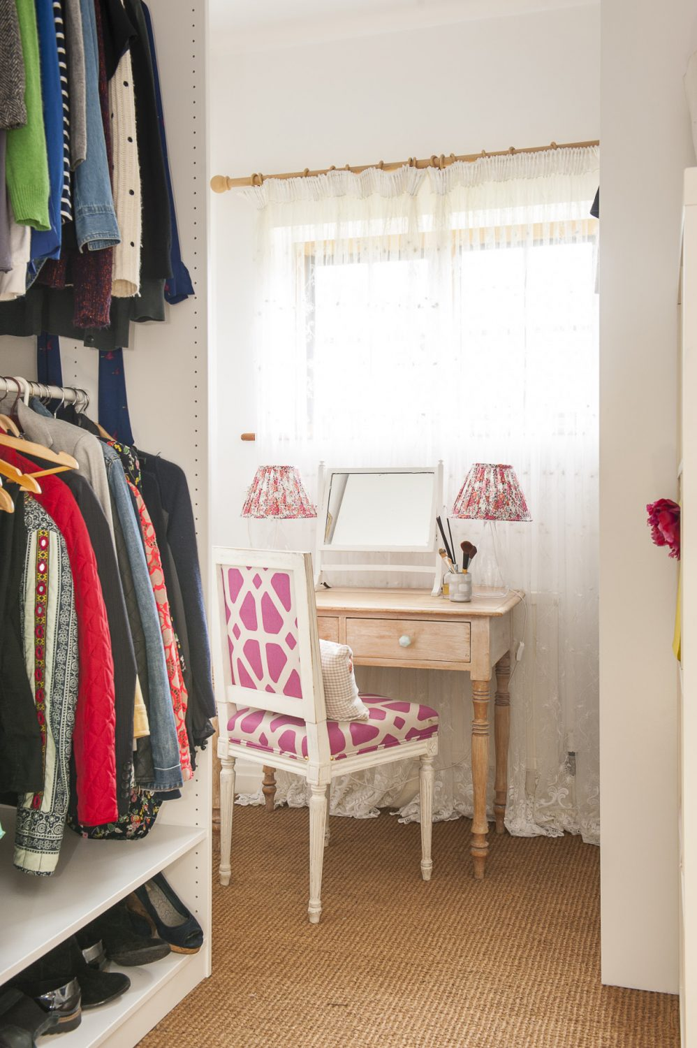 Although many of the rooms have been knocked through to create open-plan living, there are still intimate spaces such as this dressing room on the first floor