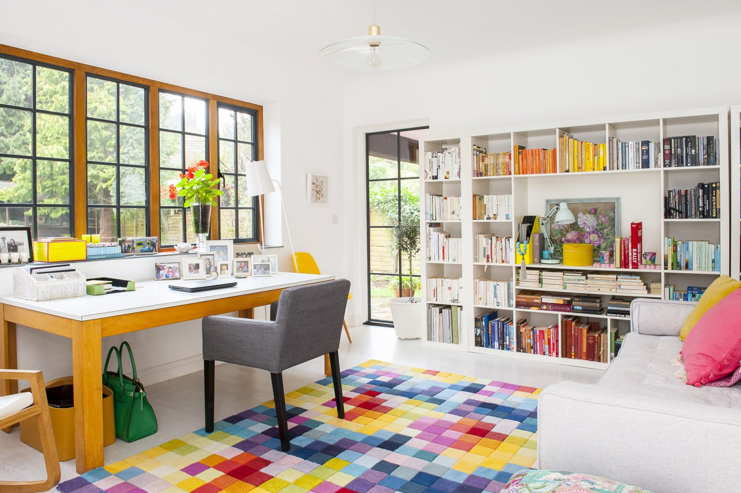 The stylish white-topped oak desk in the home office space once served as Kate and Jason's kitchen table. The white bookshelves are from Ikea and the on-trend grey sofa was £100 from Homesense. A white leather rocking chair, to the left of the picture and on the previous page, was from Habitat