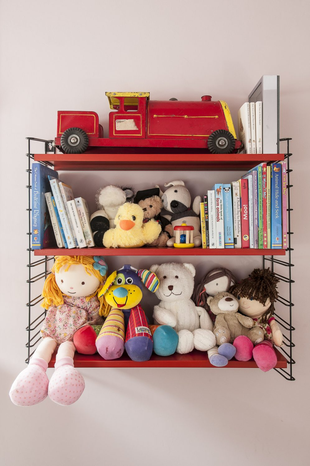 Open shelves are both practical and decorative, with this wire-work shelving unit in the nursery showing more than a hint of Justine's style
