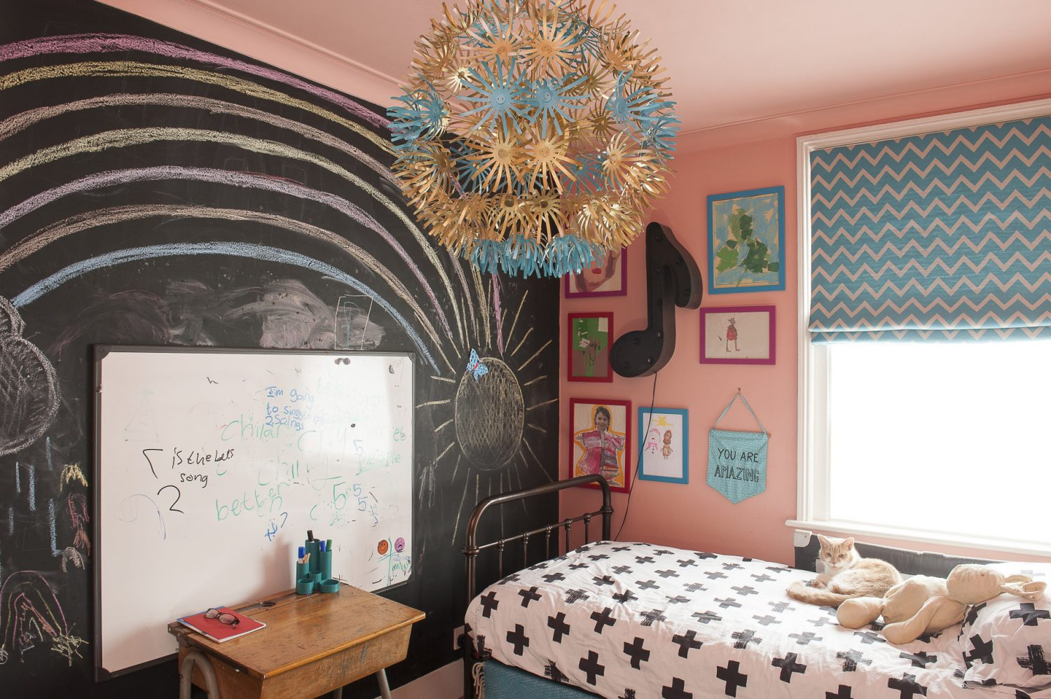 The girls' bedrooms are very much the creation of the Hodgson-Barker's eldest daughter who wants to be a teacher, so chose to have a blackboard wall as well as a white board. The wall and ceiling are painted in coral
