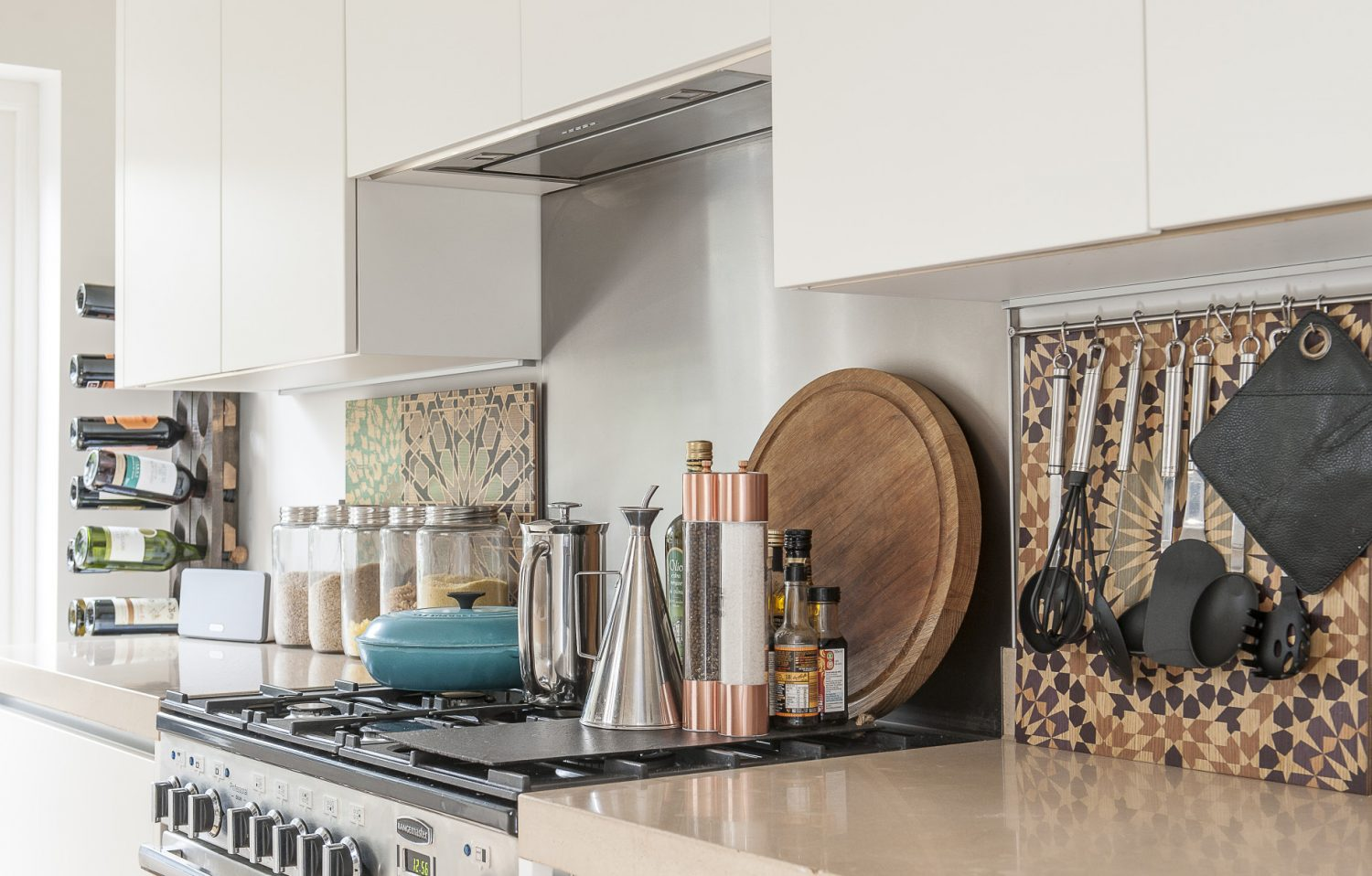Justine is on-trend with her copper-coloured kitchen accessories and complementary ply retro boards used as a splash-back
