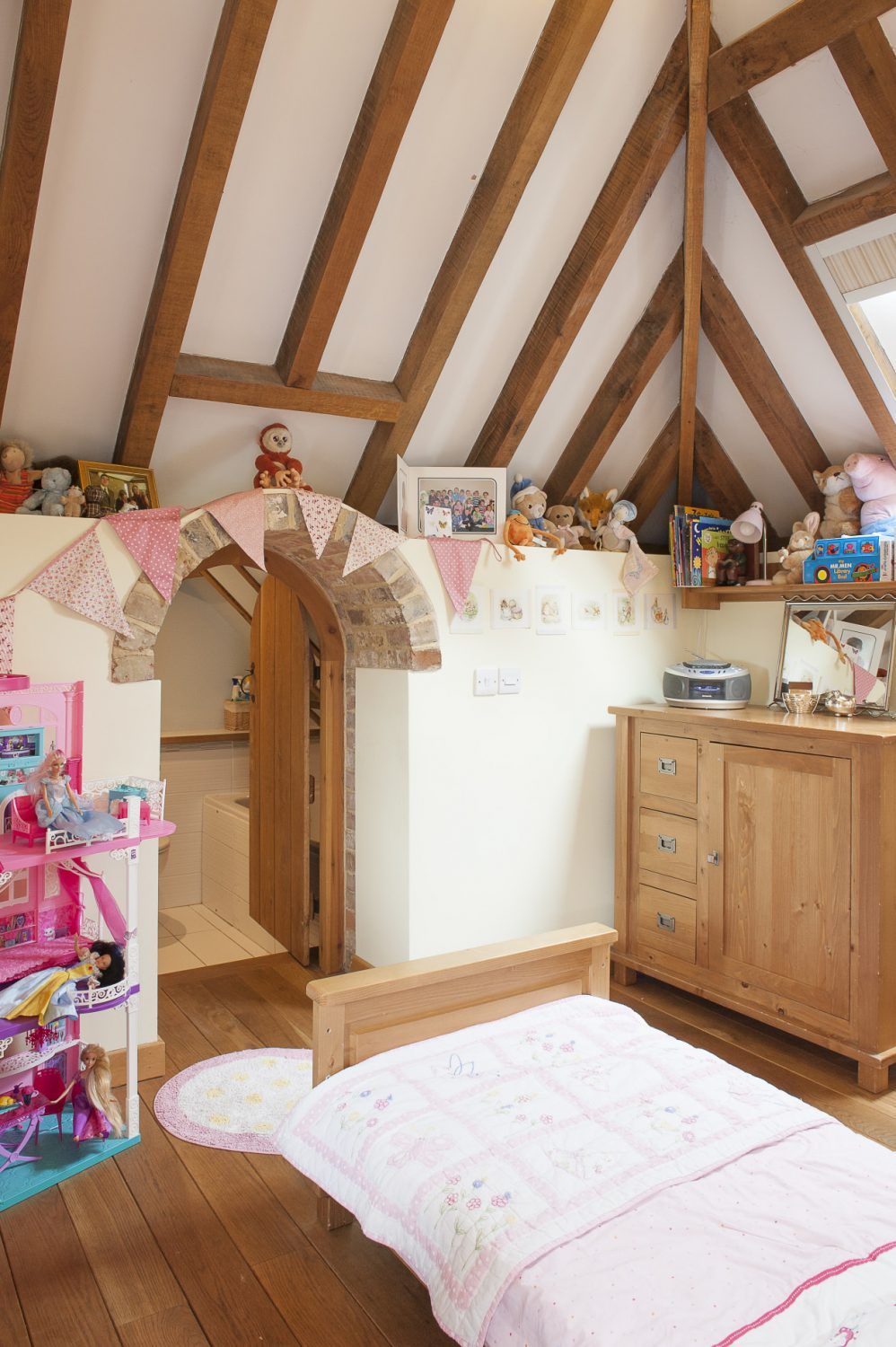 Katie has her own bathroom, accessed through a tiny child-sized doorway in her room. The floors are oak with – as elsewhere – underfloor heating powered by an air-source heat pump