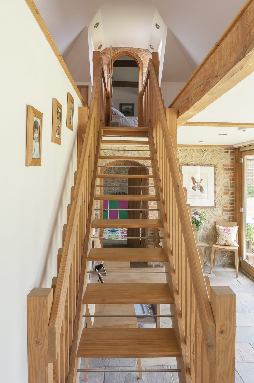 At one end of the kitchen, a staircase leads to the guest bedroom and en suite shower room