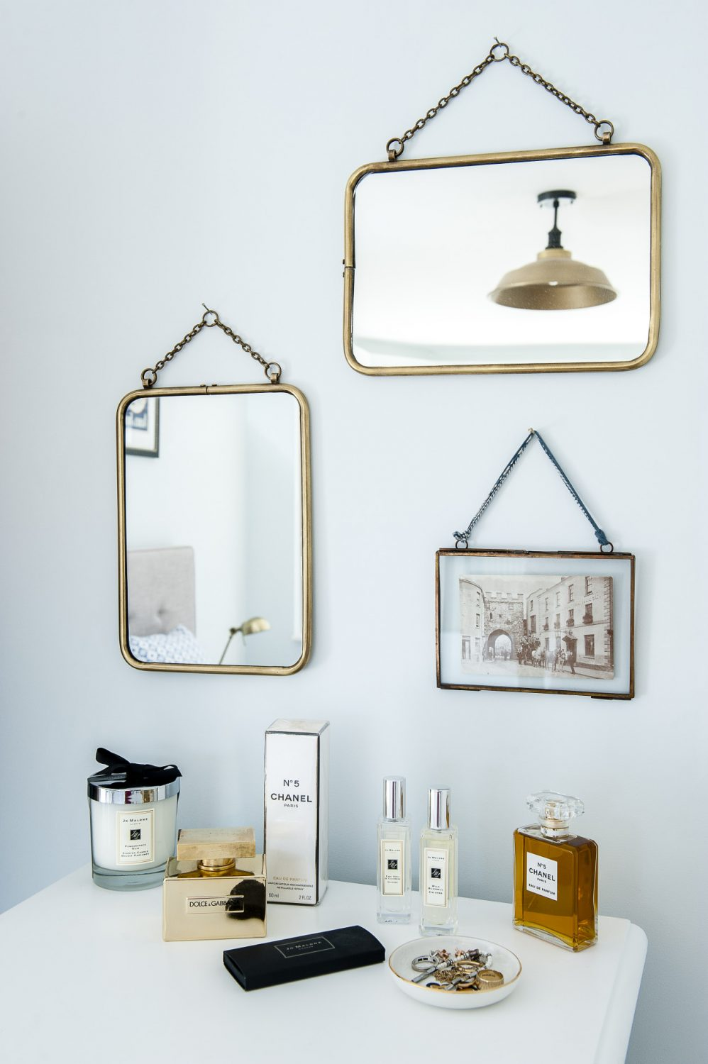 The brass-framed mirrors are from Cox & Cox. Jenna found the vintage photograph of her home town of Chepstow, South Wales and had it framed to match