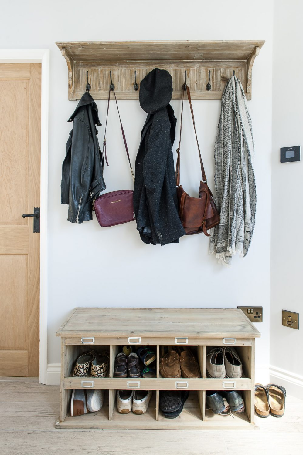 The rustic shoe cabinet in the hall is from Willow & Stone and the coat rack above from Loaf, which is based in Falmouth
