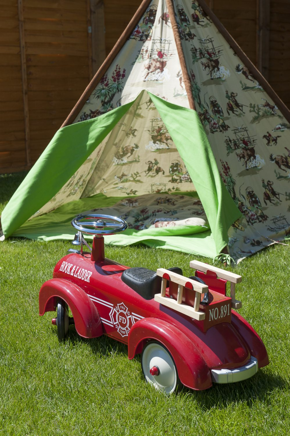 The fire truck was Charlie's first birthday present and the family brought it back from Australia, along with his cowboy print tipi by Mocka