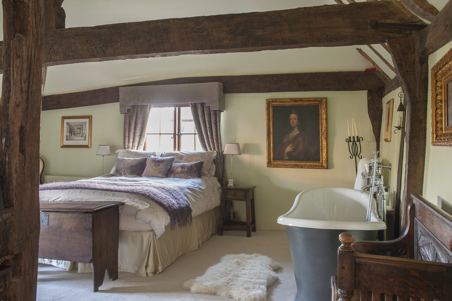 """The main bedroom has the pick of the views, across the garden to a newly built oak-framed cart shed, and paddocks beyond. It is also home to an impressive roll-top bath: """"It's meant to look like cast iron, but we would never have got it upstairs, and I was worried about the floor taking the weight,"""" says Sarah"""