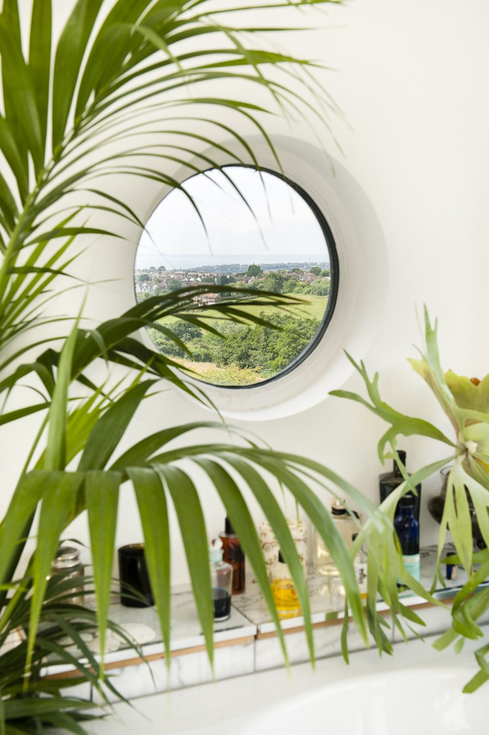 The view is framed by a porthole window