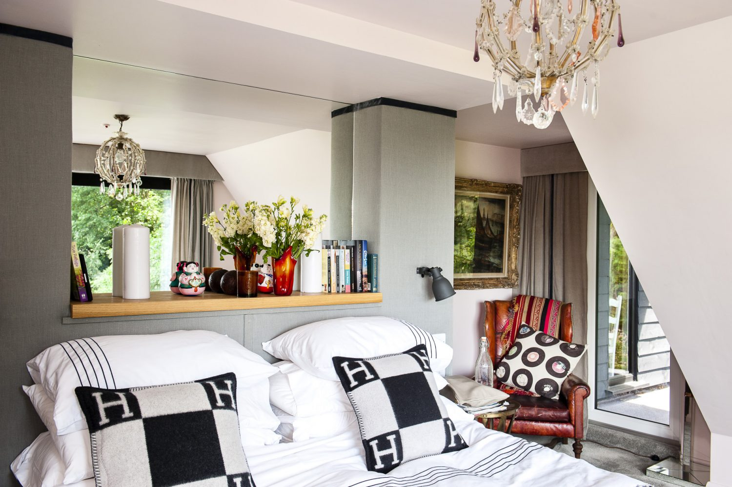 The cushions on the bed are from Hermes and the chandelier is from Rainbow lighting in Fulham