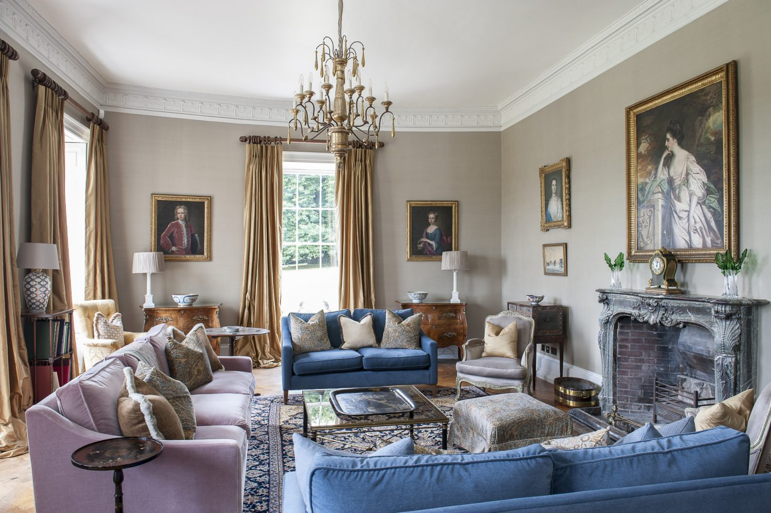 The drawing room walls are clad in de Gournay silk. The painting over the mantlepiece is of Jane Austen's favourite niece Fanny Bridges. The sofas are from sofa.com