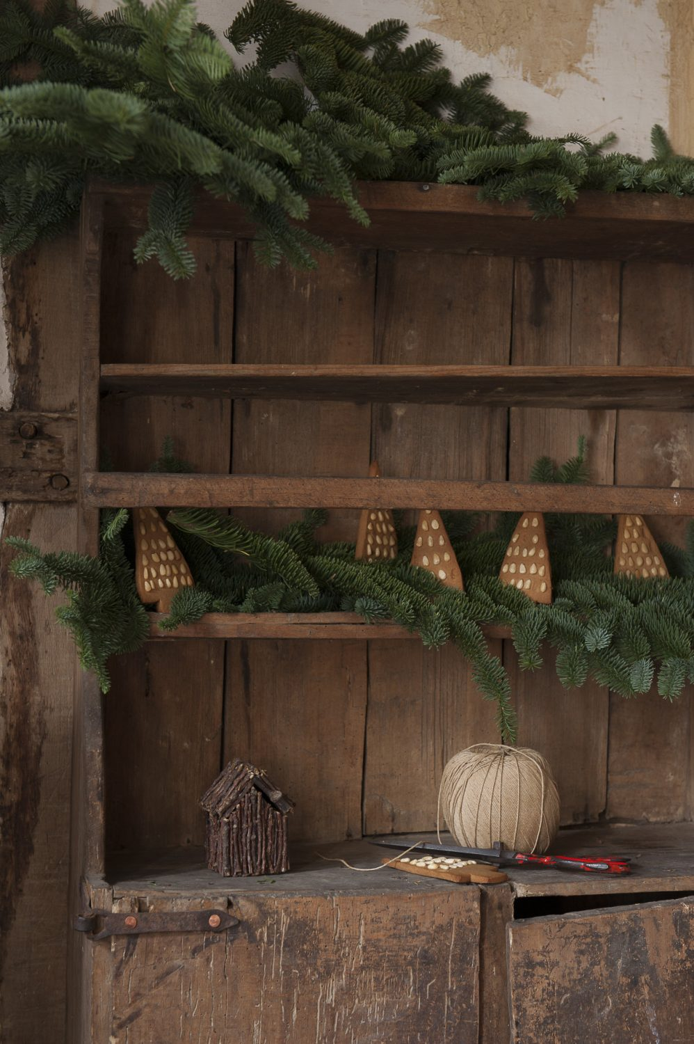 The decorations throughout the house are subtle and understated, and also have a European feel. There are branches of blue fir, simple gingerbread hearts hung with red ribbon and pine nut studded 'trees' propped on shelves...