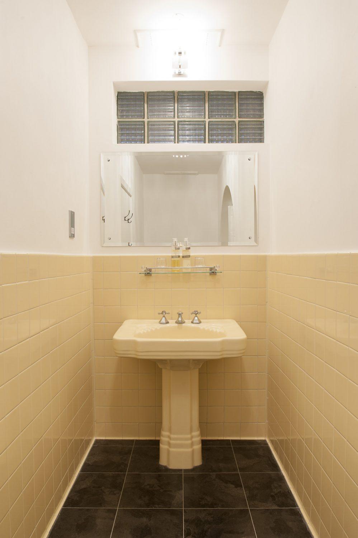 One still retains its original yellow en suite bathroom