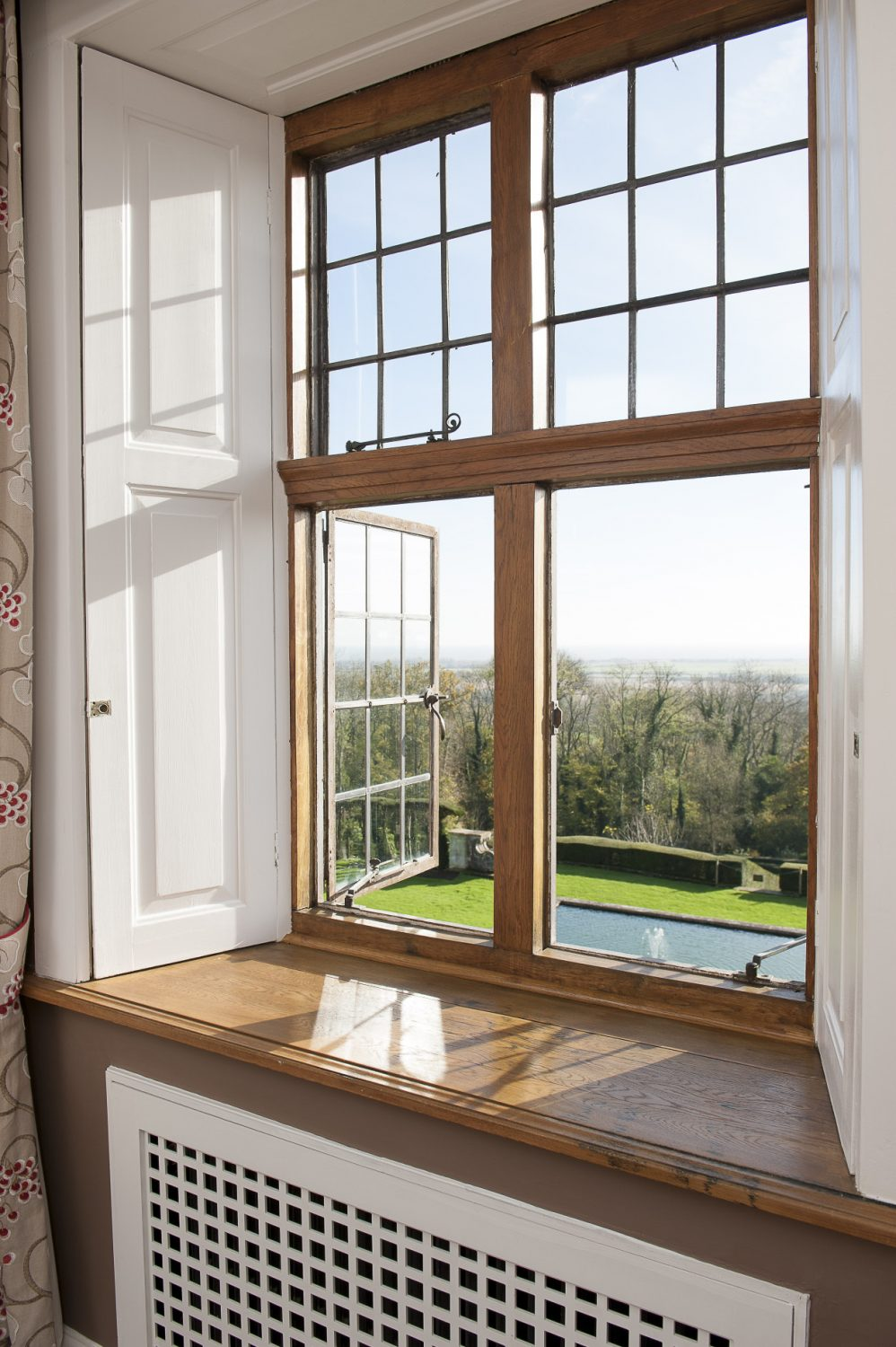 The bedrooms benefit from stunning views across the extensive gardens and out towards the sea.