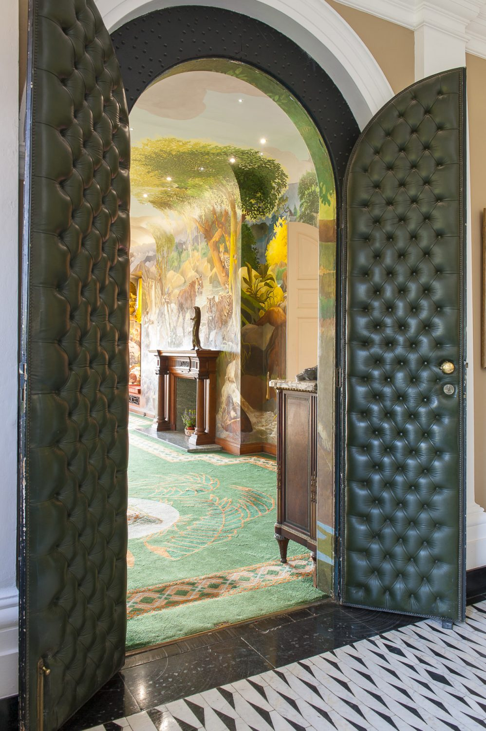 A pair of soft leather-covered doors opens to reveal the Spencer Roberts room, where many of Port Lympne's wedding receptions take place
