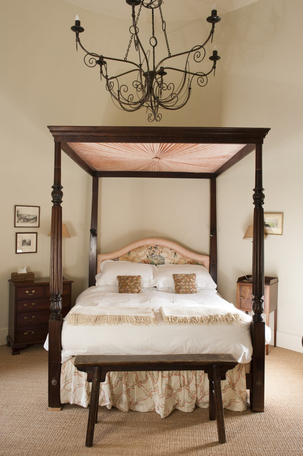 The four-poster bed belonged to Ally's parents and the wire-work chandelier was bought in Africa