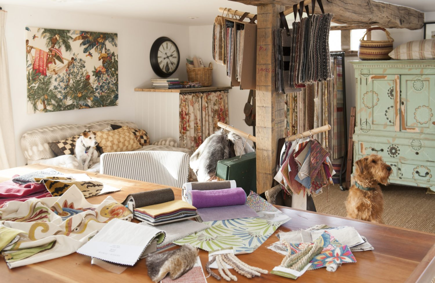 Downstairs, reached via French doors which face out on to the garden, is Ally's office and work room. The room is filled with luscious fabric samples, wallpaper books and haberdasher's goodies
