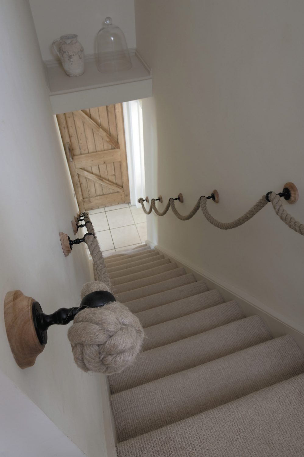 The staircase leads from the internal hallway