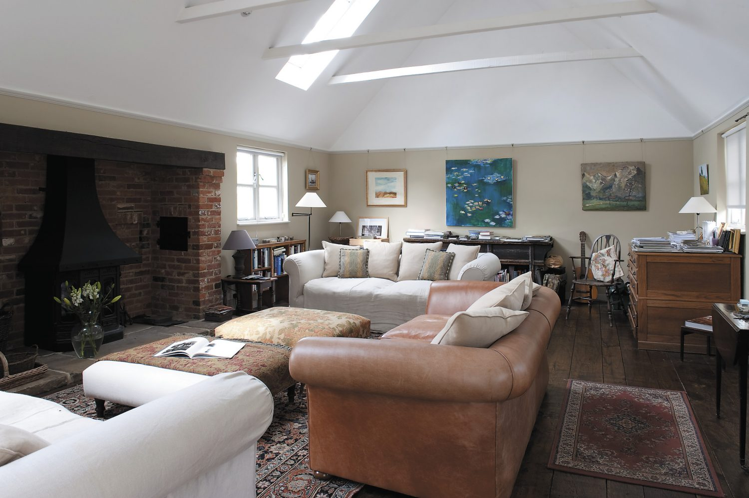 The spacious sitting room is in the extension and is flooded with light and space