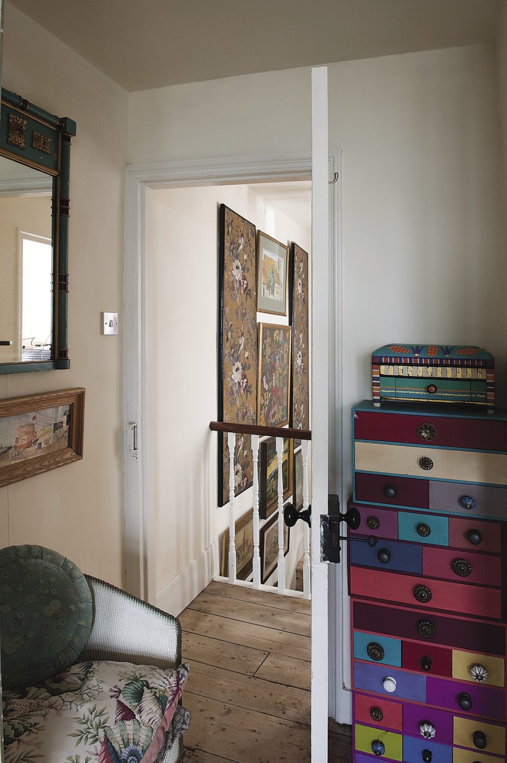 In one corner of the bedroom, Helen has stacked four sets of small chests of drawers that she colour-coded according to her beads