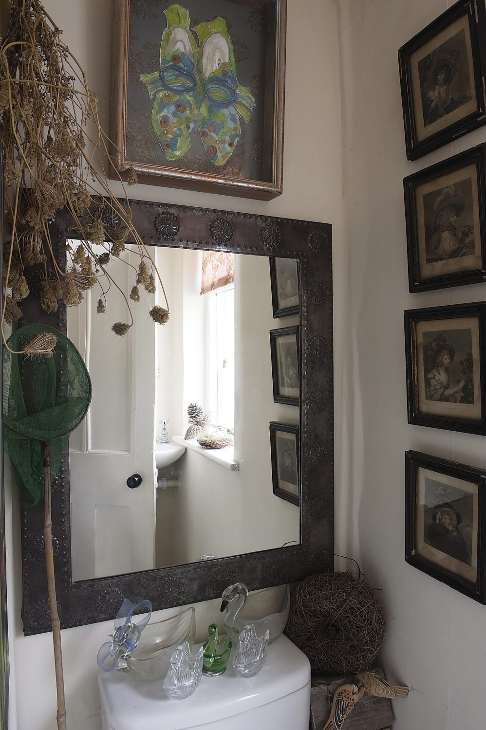 The upstairs loo is home to some of Helen's swan collection, this time in glass
