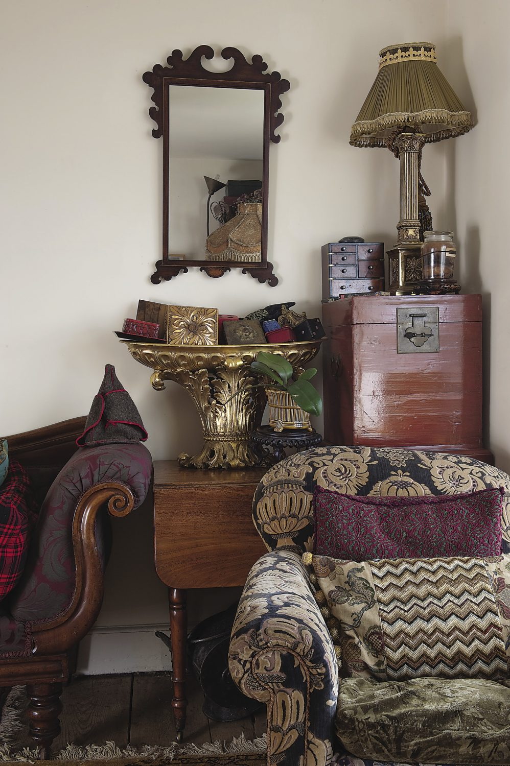 the carved mahogany sofa came from Helen's aunt Lucy and is upholstered in rich burgundy brocade