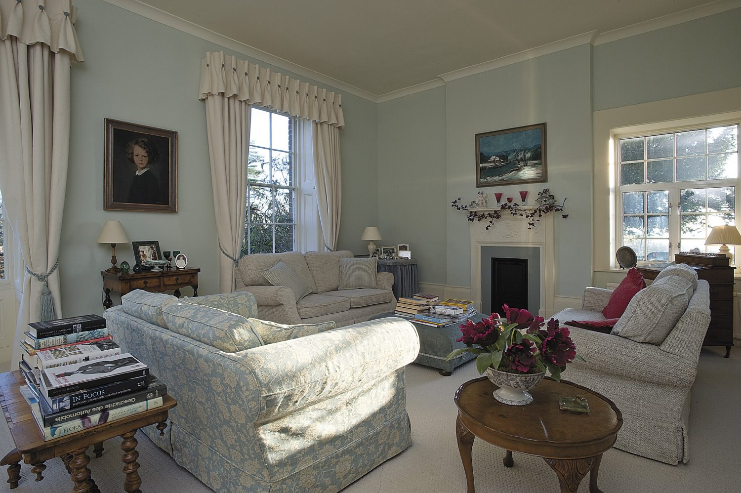 the high-ceilinged drawing room is in the Georgian part of the house