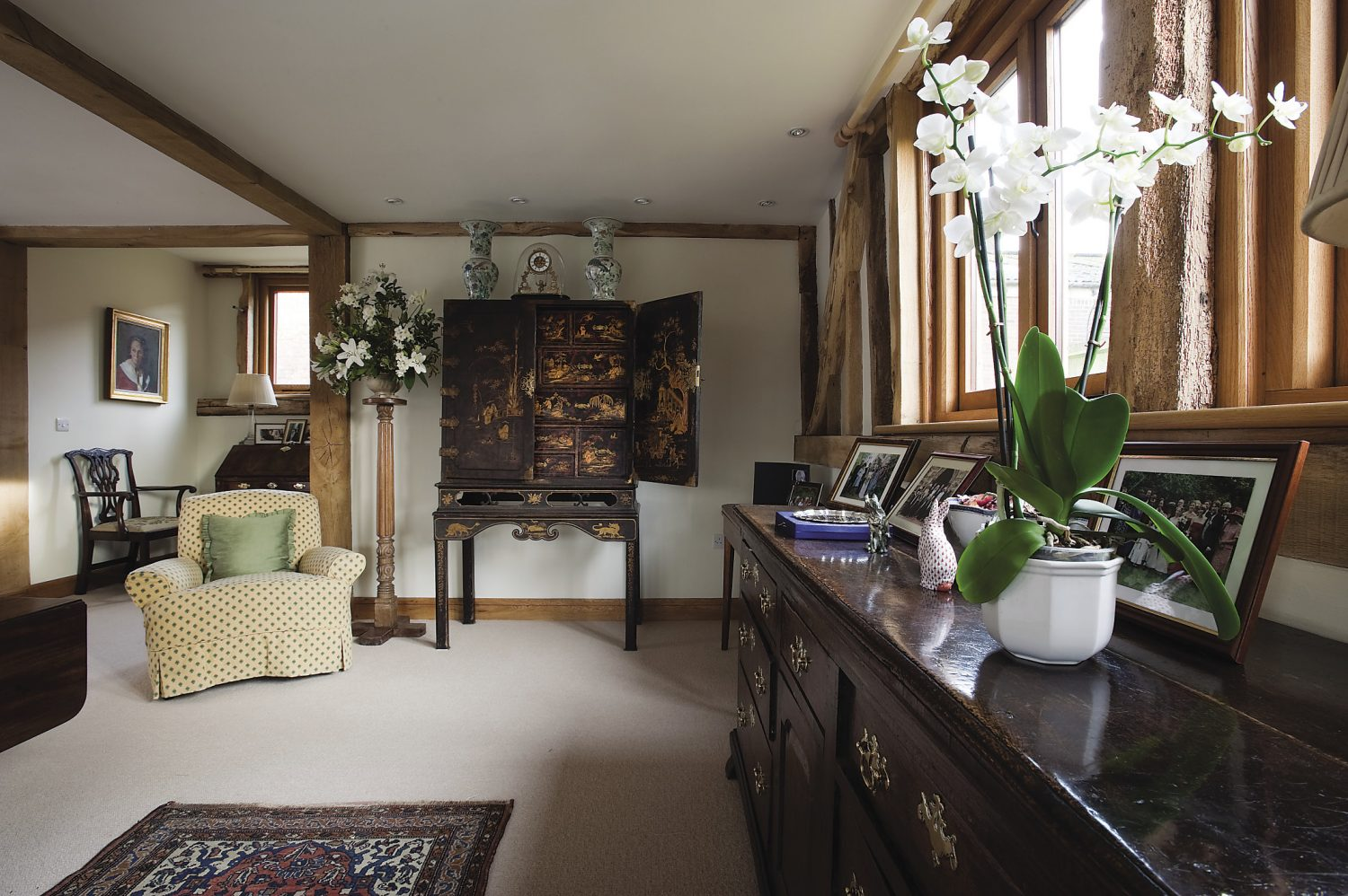 a flamboyant chinoiserie is situated next to a Derbyshire dresser