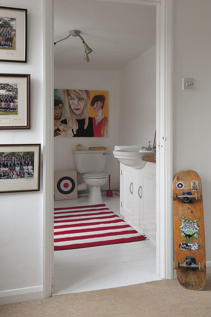the large painting in the family bathroom is by John and Sandy's art student daughter Grace