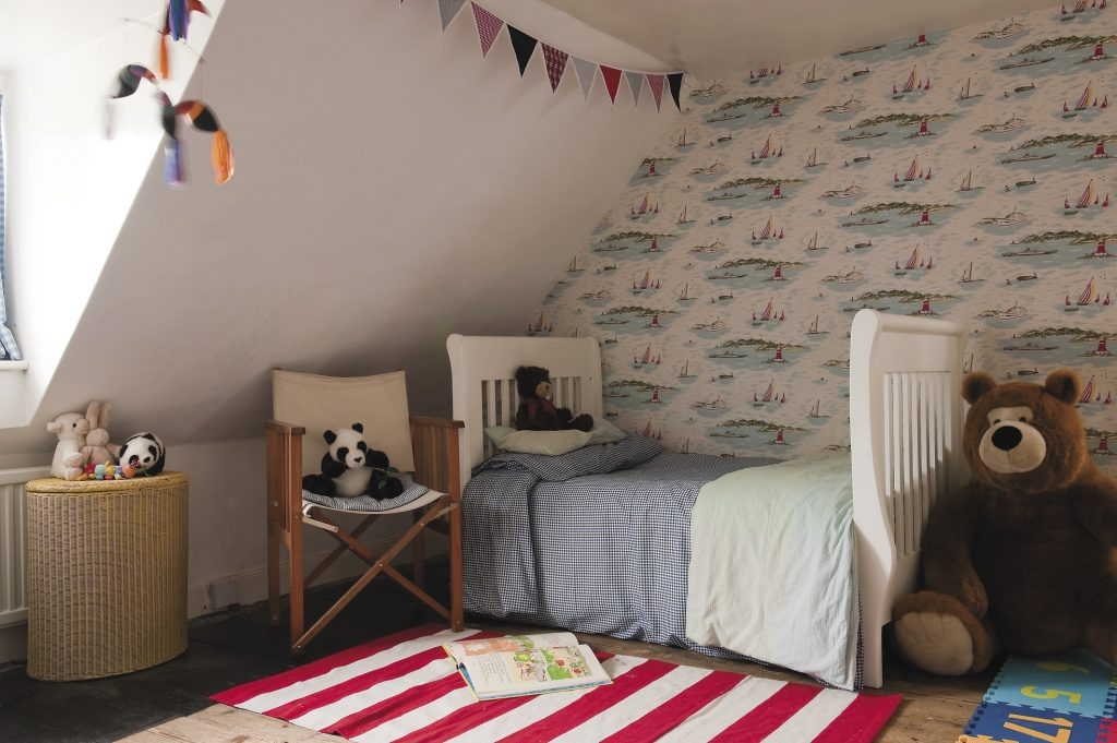the boys' attic bedrooms are decorated with Kath Kidston sailing boats