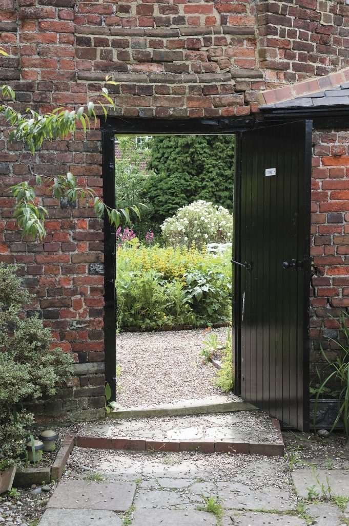 a glimpse of the walled garden from the family's private courtyard