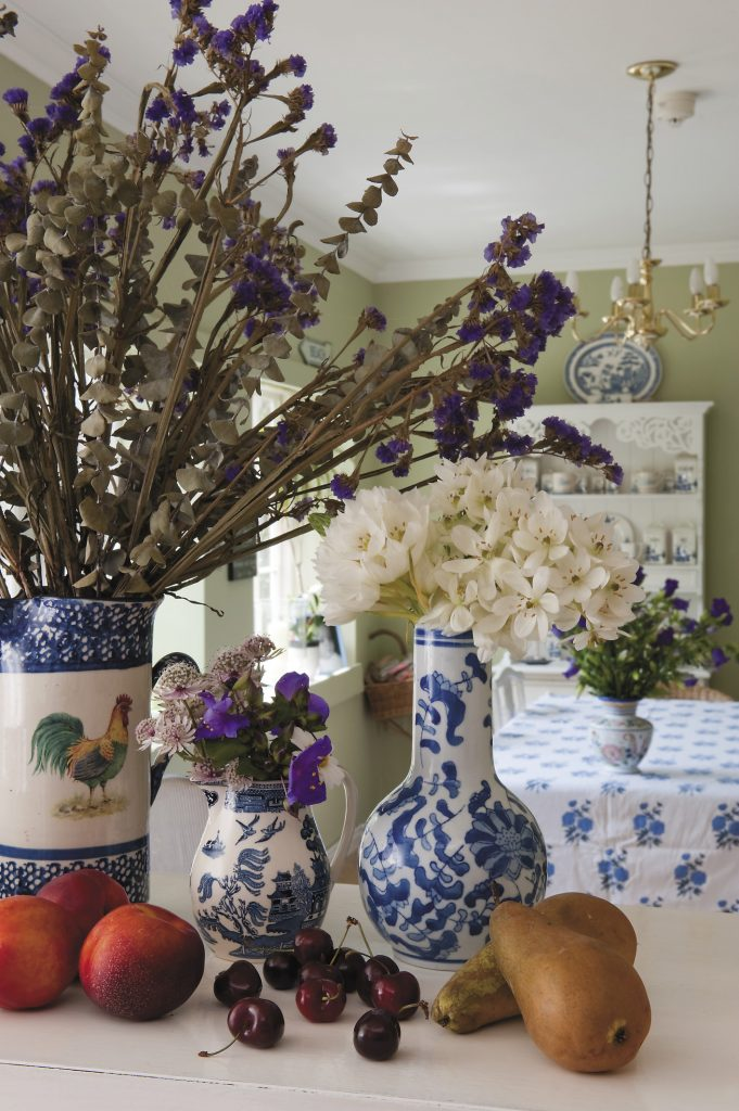 breakfast room at Lamb House where the apple green walls and blue and white china and fabric were added by Francesca