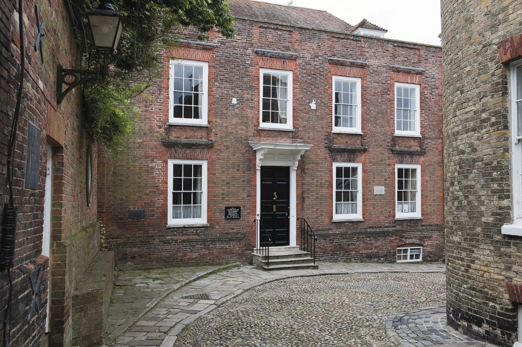the imposing facade of Lamb House from the cobbles on West Street, in Rye