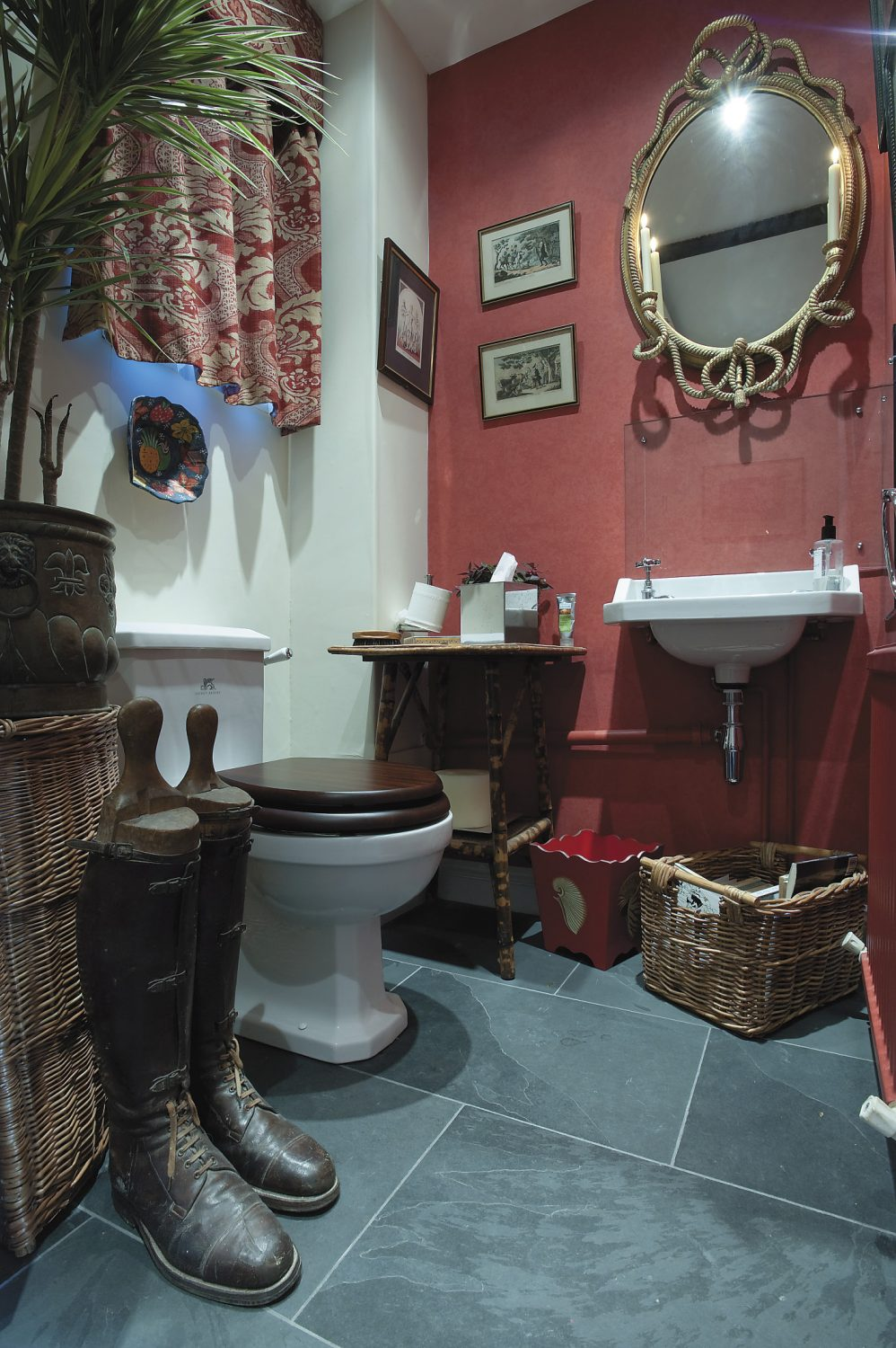 the antique, rope-effect mirror in the flamboyant downstairs loo was bought at auction from Gorringes ...