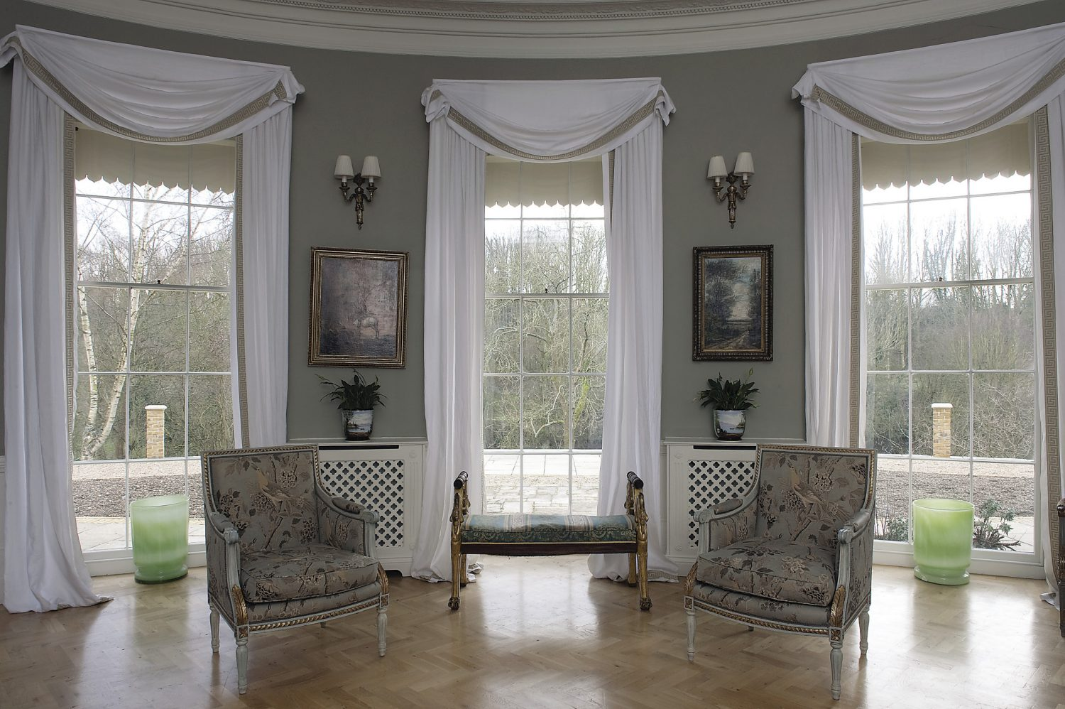 the impressive drawing room. A pair of Directoire style chairs have been covered with Bennison's Indian bird fabric.