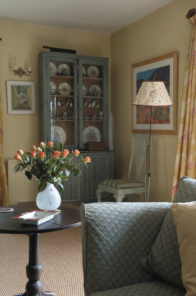 the curtains in the sitting room were designed by Victoria and one of her daughters hand painted the lampshade, both combining to give a very 'Charleston' effect
