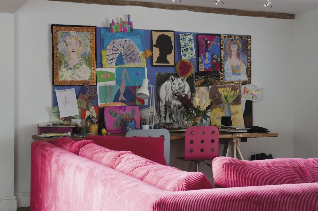 a selection of the girls' paintings in the playroom decorate one end. The 'Botticelli' and 'Gainsborough' portraits are particular favourites
