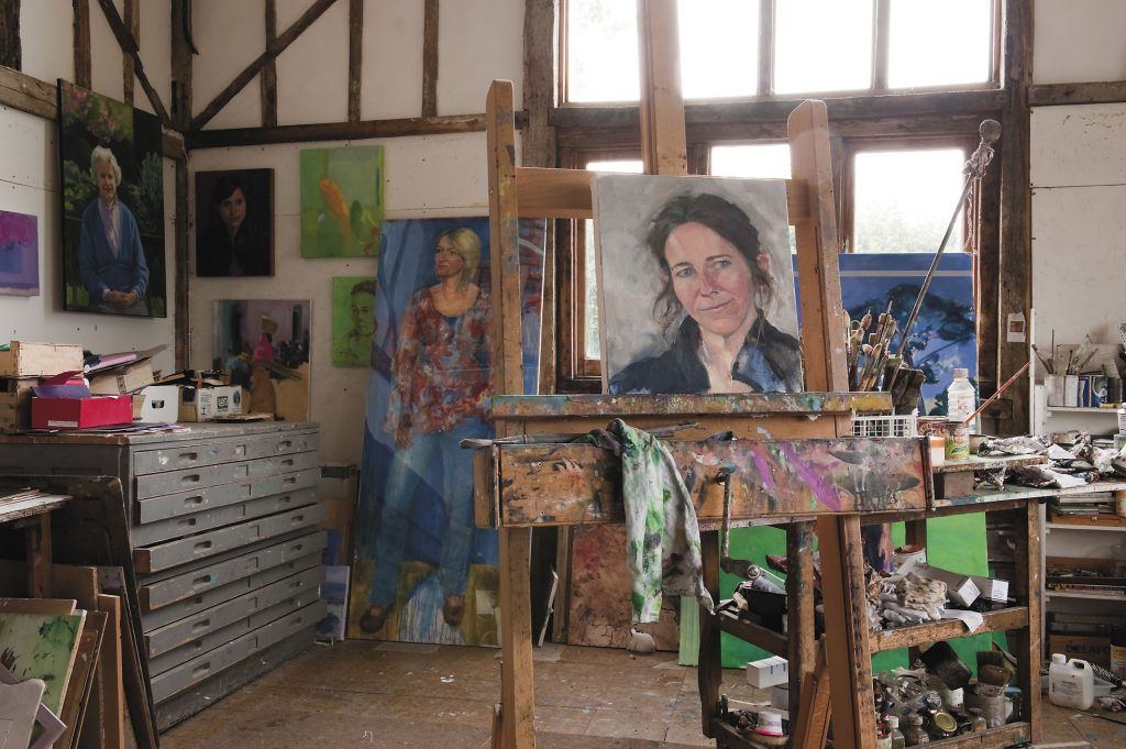 the light and airy barn at the bottom of the garden has been renovated to create the perfect artist's studio
