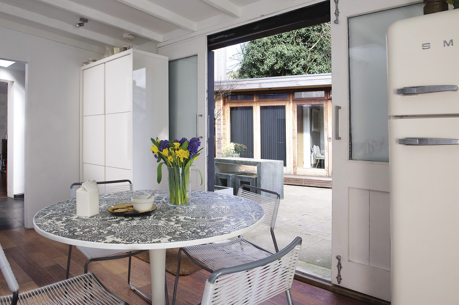 the kitchen, designed by local architect Robert George, leads out into the u-shaped central courtyard
