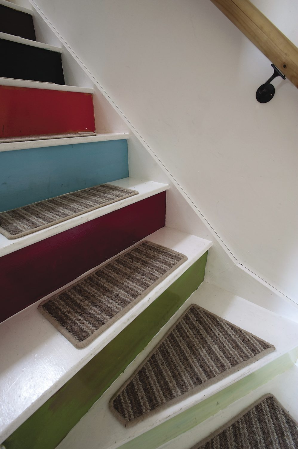 Brightly painted steps lead up to the bedrooms on the second floor.