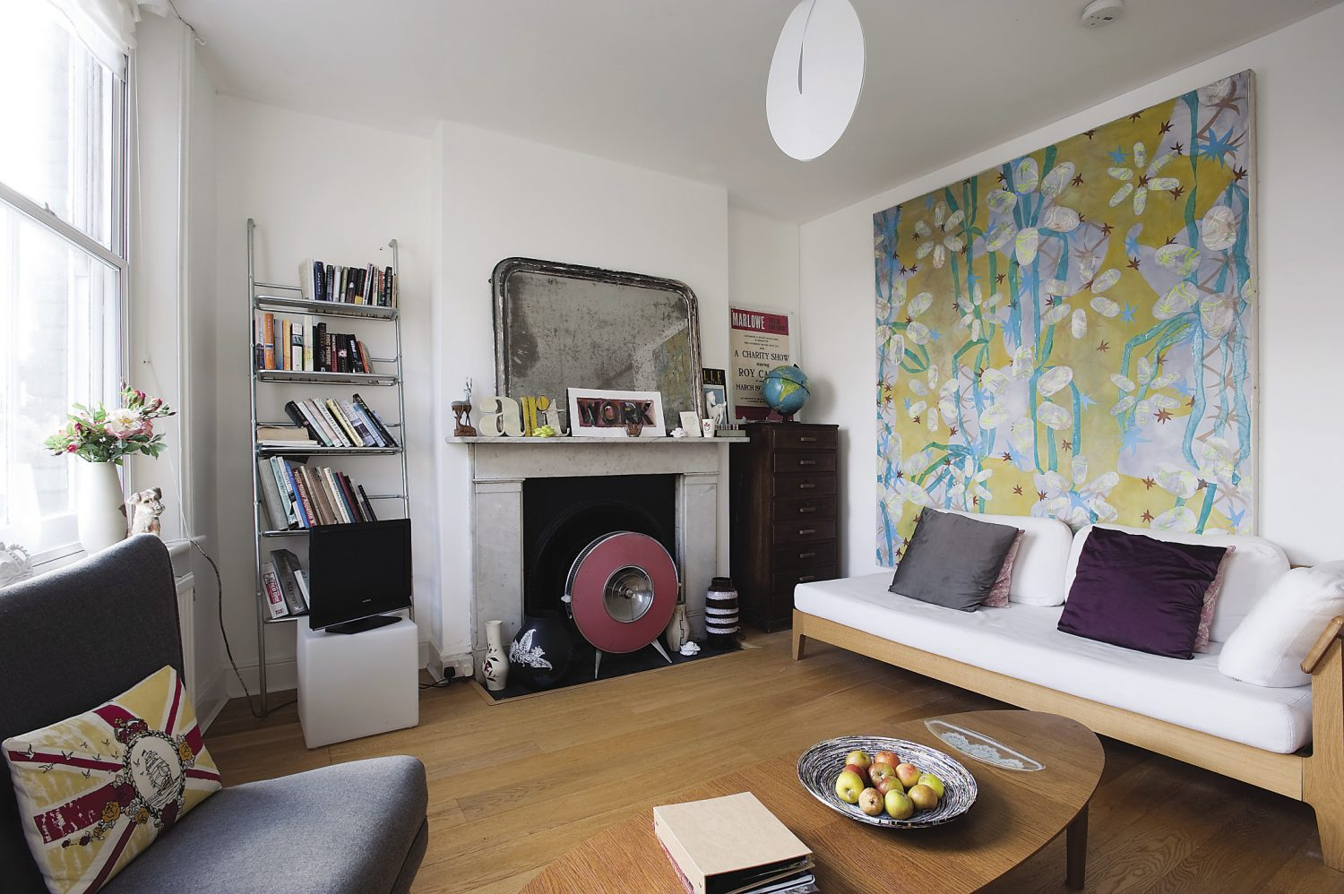 The guests' sitting room displays a huge painting in vibrant colours by Maisie Kendall, RA