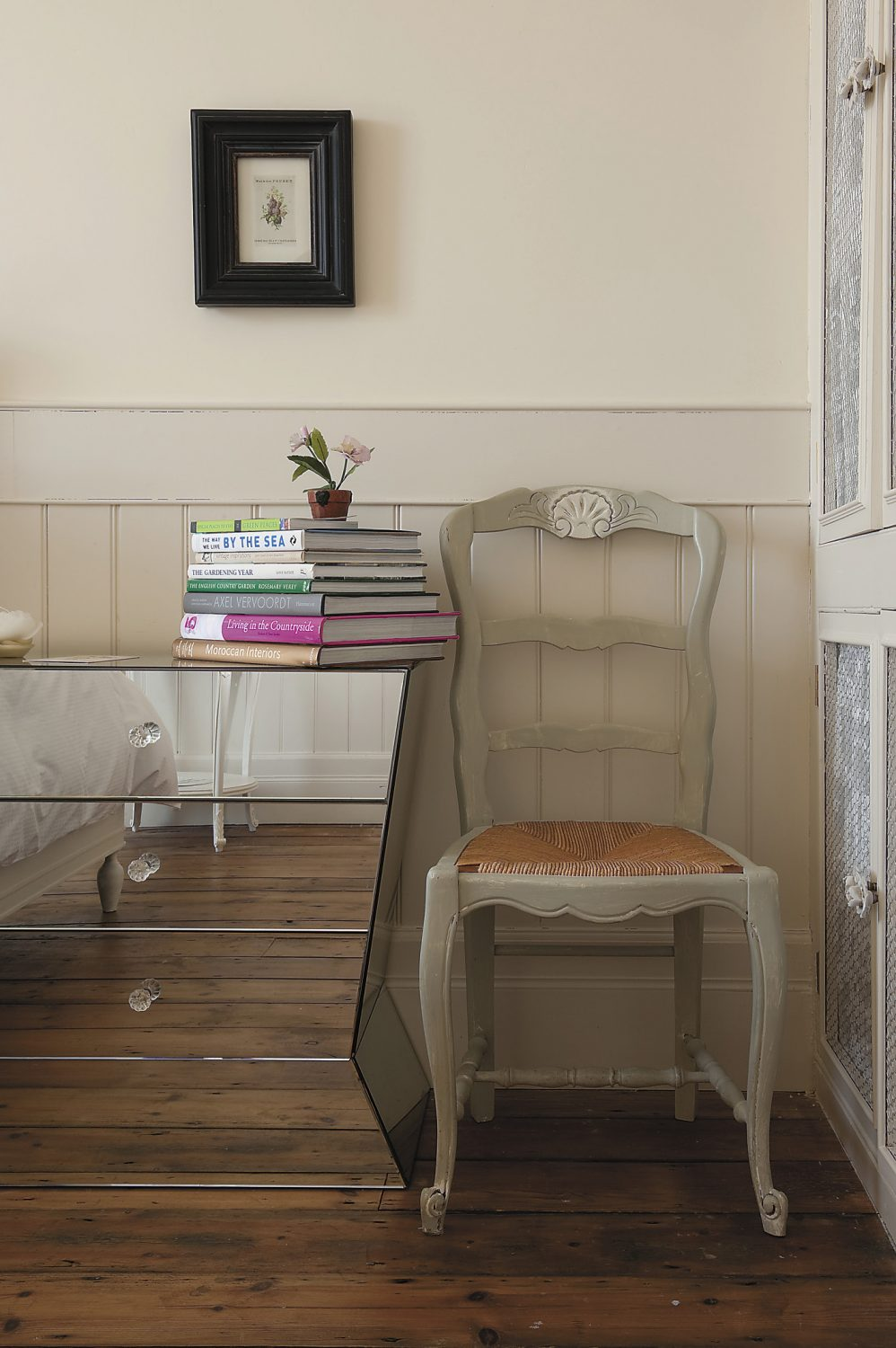 the house is home to a host of interiors books that Vickie has collected and from which she has drawn inspiration, some of which are displayed on the Venetian-style bedside table in one of two guest bedrooms