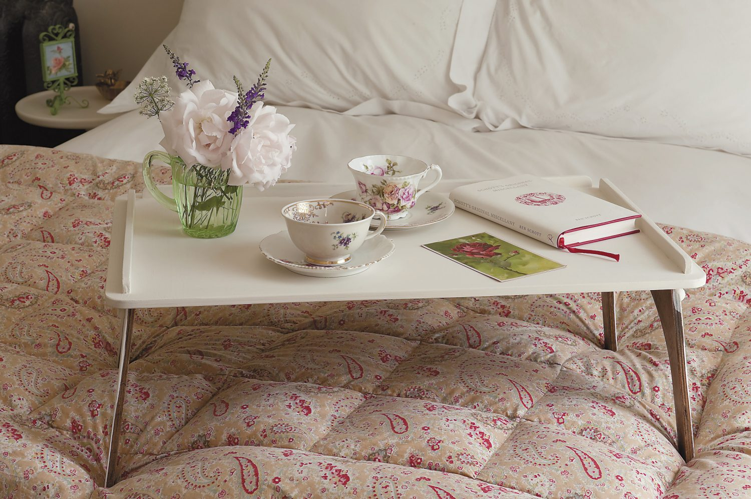 Vickie's enviable eye for detail is evident in every room of the house. Here in the ground-floor guest bedroom, a breakfast tray is laid out on the paisley bedspread in anticipation of the arrival of the next guests