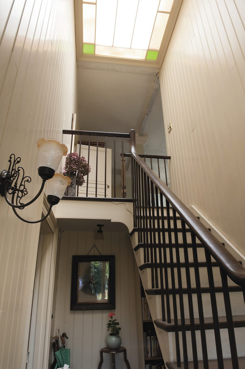 Stroll into the cool hallway and upstairs beneath a stained-glass skylight – the house is built on a steep incline so the main living space is on the first floor – and you're no longer in America nor England but France