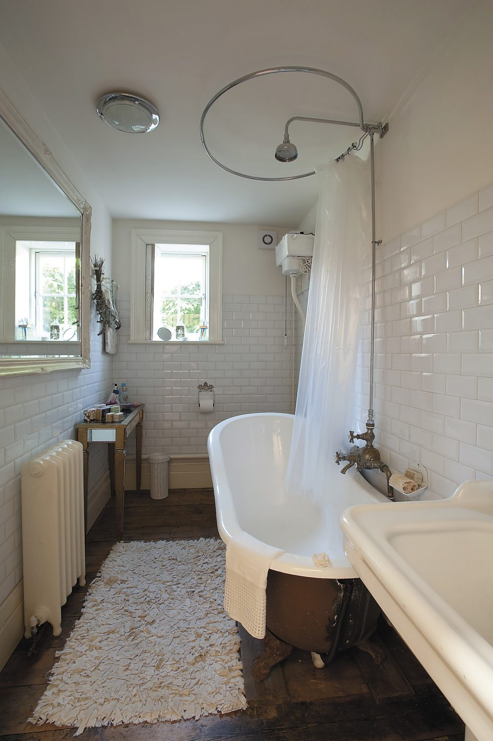 the ground-floor bathroom features a reclaimed roll-top bath and Vickie and Graham have retained all the original tap fittings