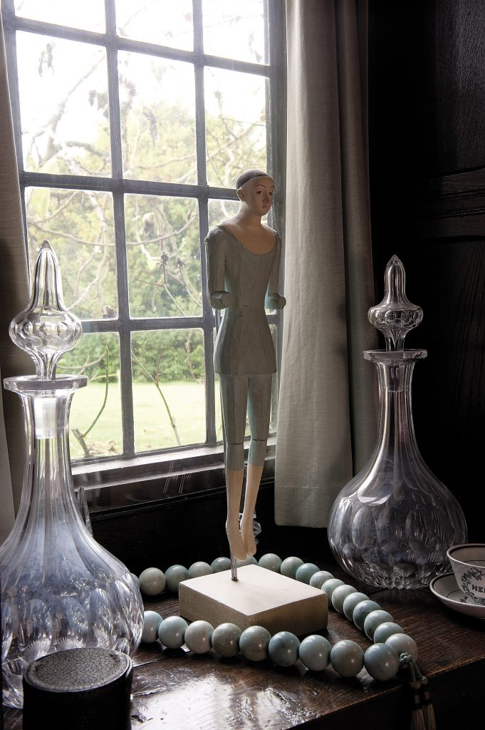 A window in the corner of the drawing room overlooks the garden