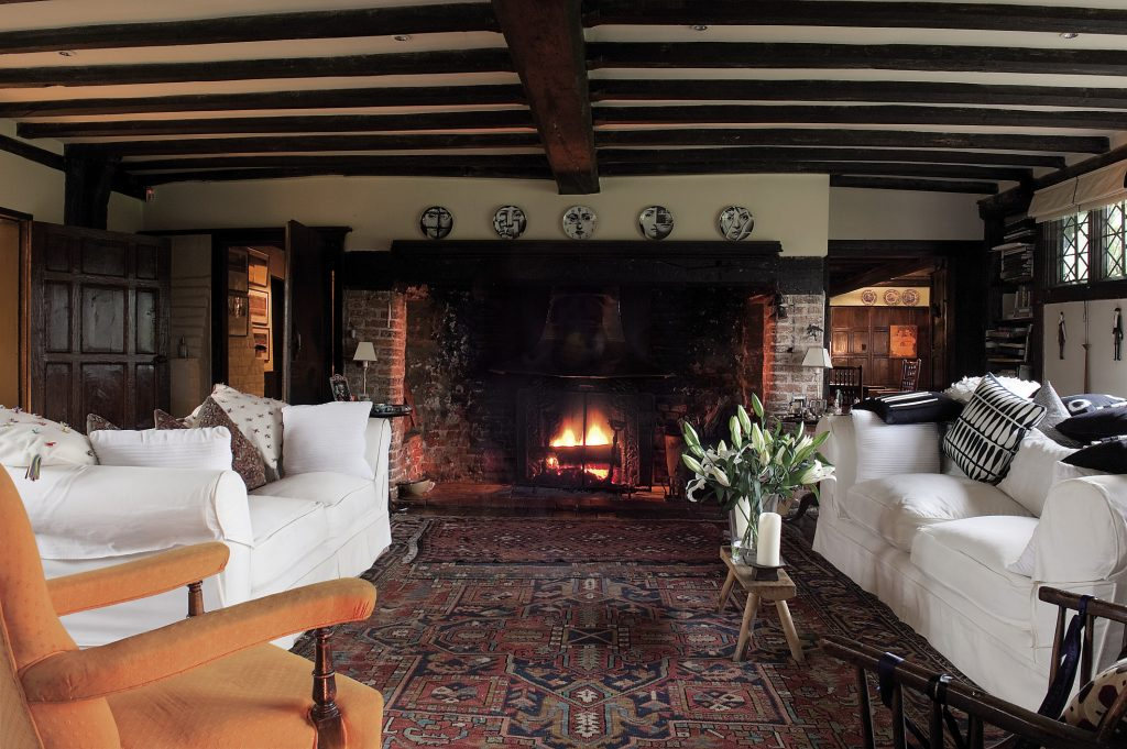 Centre and heart of the house is the glorious 25-foot drawing room with its huge inglenook and pleasingly imperfect, centuries-old oak floorboards over which are scattered a collection of equally pleasingly imperfect eastern rugs