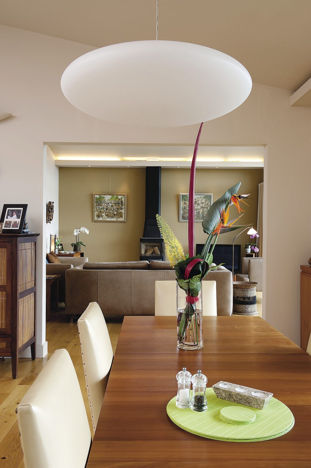 Through the use of clean, simple lines, the kitchen naturally flows into the dining area