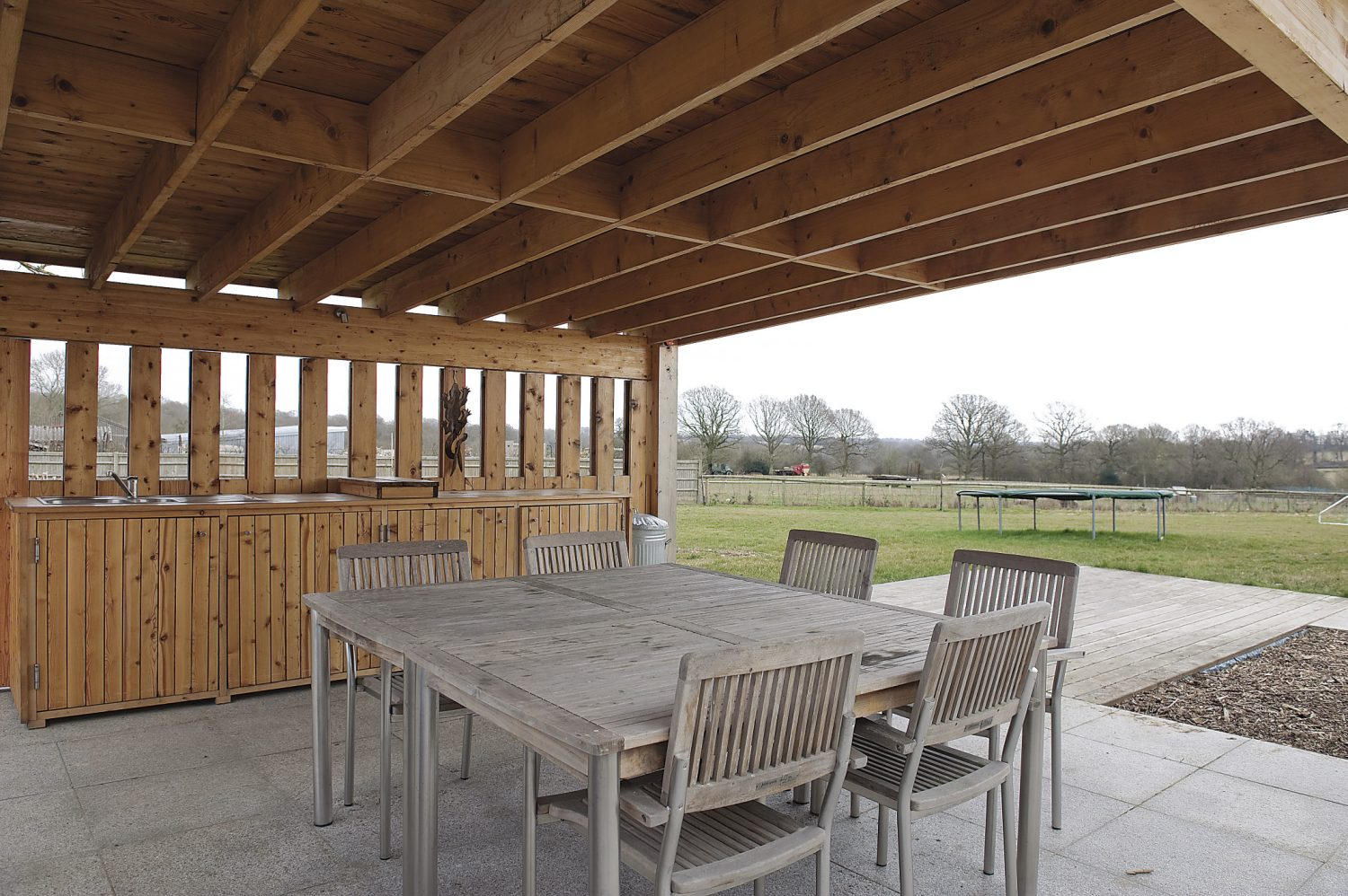 The pool area boasts a fantastic outdoor kitchen and dining area