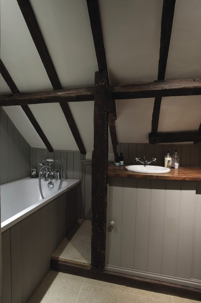 The master bedroom en suite is nestled in the eves of the second floor