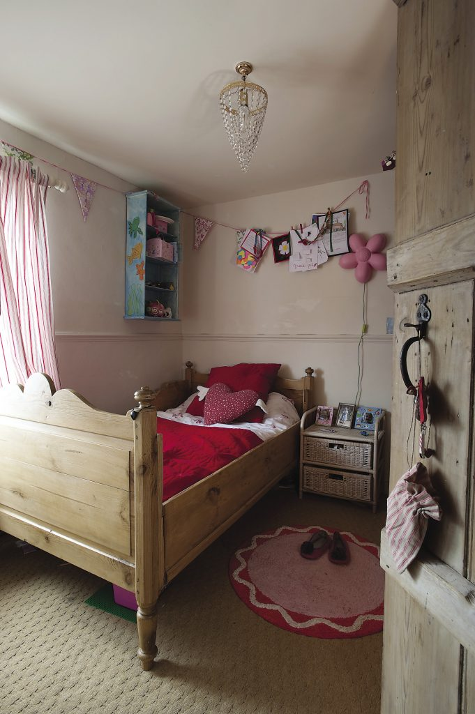 """The delightful sleigh bed was bought at Sissinghurst Antiques for just £30. """"It was covered in graffiti,"""" explains Stella, """"and looked terrible, but after several experiments I found that bicarbonate of soda got rid of it."""""""